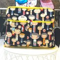 Bolso carro bebé kokeshi con amarillo