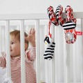 Espiral juguete carrito bebé - mapache rojo